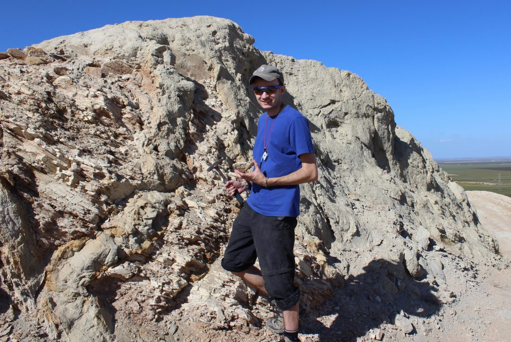 PhD student Ben Callow photographed sampling one of the smaller sandstone injectites found within the Panoche Hills