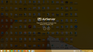 A dimmed desktop with an AirServer logo showing a tick and cross to accept or reject a connection from a Sony phone