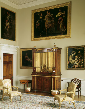 The Music Room, Kedleston. View of the organ case, designed by Robert Adam and carved by James Gravenor in 1765. A pair of c18th kettle drums stand in front of the organ.