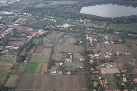 Aerial view northwards over the Isola Sacra towards Portus, with the cemetery (left), the Fossa Traiana canal (centre) and the Trajanic basin (background) (Photo: Simon Keay/ Portus Project)