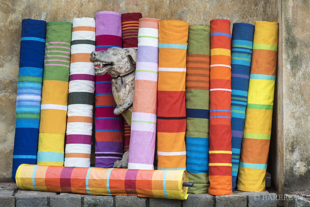 Rolls of hand woven cloth designed by BAREFOOT. Image courtesy of image credit for Barefoot Ceylon.